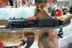 MTH train above ravine in Department 56 Snow Village