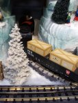 MTH train going into tunnel in Department 56 Snow Village